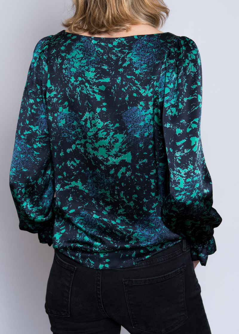 silk blouse, ruffled cuff detail, abstract blue and green print.
